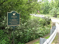 Photo of the one lane Kettleby Bridge and plaque in Kettleby, Ontario
